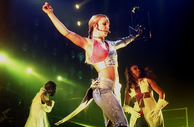 American pop singer Britney Spears performs on stage during her Oops!... I Did It Again Tour in Flanders Expo, Ghent, Belgium, 18 October 2000. (Photo by Paul Bergen/Redferns)