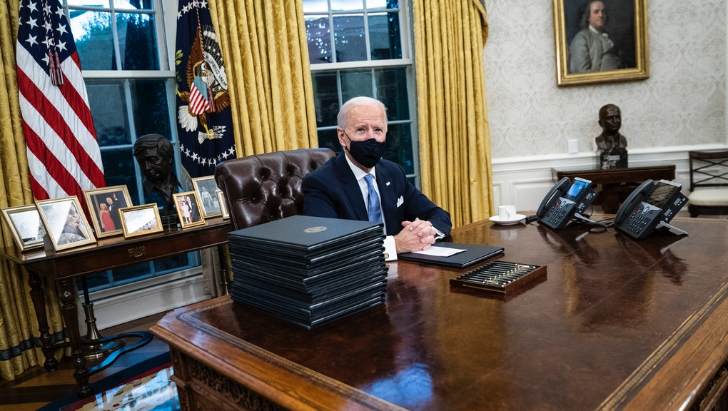WASHINGTON, DC - JANUARY 20: President Joe R. Biden speaks and signs executive orders in the Oval Office at the White House on Wednesday, Jan 20, 2021 in Washington, DC. Earlier in the day he was sworn In as 46th President of the United States. (Photo by Jabin Botsford/The Washington Post via Getty Images)