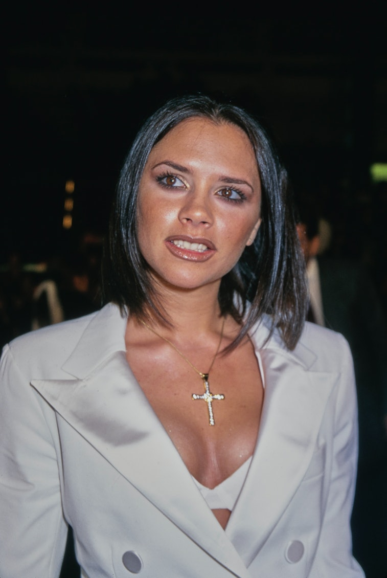 """""""Posh Spice"""" Victoria Adams attends the """"Spice World"""" Hollywood Premiere at the Mann's Chinese Theatre in Hollywood, California, US, 22nd January 1998. (Photo by Vinnie Zuffante/Michael Ochs Archives/Getty Images)"""