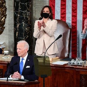 US President Joe Biden is greeted by US Vice President Kamala Harris (C) and Speaker of the United S...