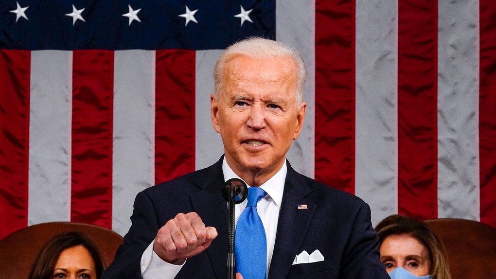US President Joe Biden, flanked by US Vice President Kamala Harris (L) and Speaker of the House of Representatives Nancy Pelosi (R), addresses a joint session of Congress at the US Capitol in Washington, DC, on April 28, 2021. (Photo by Melina Mara / POOL / AFP) (Photo by MELINA MARA/POOL/AFP via Getty Images)