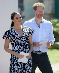 CAPE TOWN, SOUTH AFRICA - SEPTEMBER 23:  Meghan, Duchess of Sussex and Prince Harry, Duke of Sussex smile as they visit a Justice Desk initiative in Nyanga township, during their royal tour of South Africa on September 23, 2019 in Cape Town, South Africa. The Justice Desk initiative teaches children about their rights and provides self-defence classes and female empowerment training to young girls in the community.  (Photo by Chris Jackson/Getty Images)