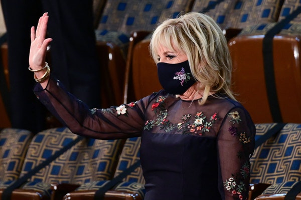 US First Lady Jill Biden waves as she waits for the arrival of US President Joe Biden to address a joint session of Congress at the US Capitol in Washington, DC, on April 28, 2021. (Photo by JIM WATSON / POOL / AFP) (Photo by JIM WATSON/POOL/AFP via Getty Images)