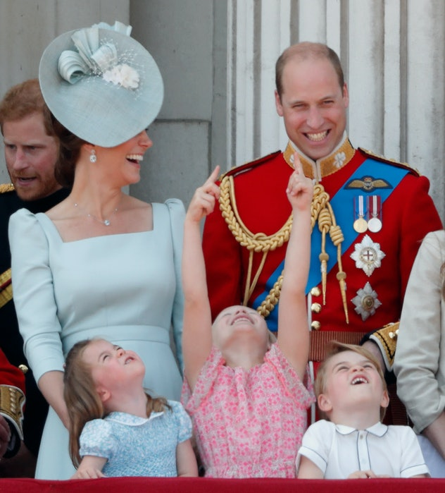 Prince William and Kate Middleton laugh together.