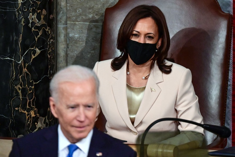 US Vice President Kamala Harris (R) looks on as US President Joe Biden addresses a joint session of Congress at the US Capitol in Washington, DC, on April 28, 2021. (Photo by JIM WATSON / POOL / AFP) (Photo by JIM WATSON/POOL/AFP via Getty Images)