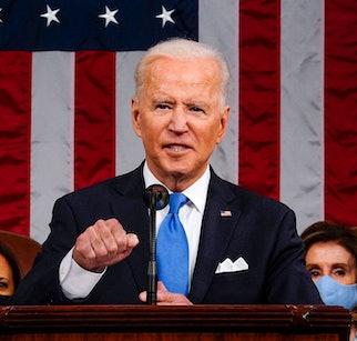 US President Joe Biden, flanked by US Vice President Kamala Harris (L) and Speaker of the House of R...