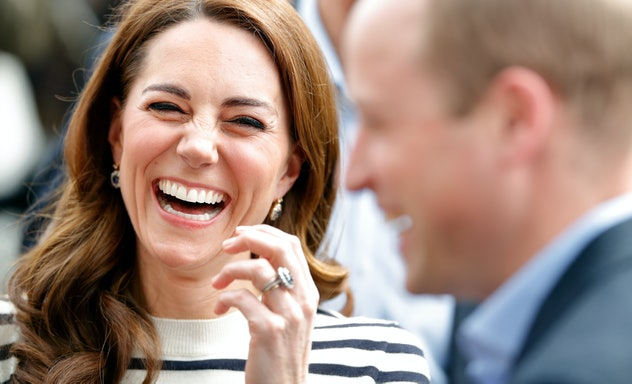 Prince William and Kate Middleton laughing together.