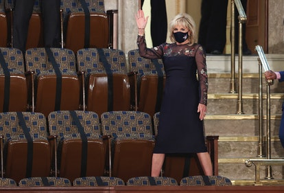 US first lady Jill Biden waves as she arrives for US President Joe Biden's address to a socially distant joint session of the Congress at the US Capitol in Washington, DC, on April 28, 2021. (Photo by JONATHAN ERNST / POOL / AFP) (Photo by JONATHAN ERNST/POOL/AFP via Getty Images)