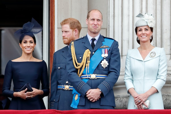 LONDON, UNITED KINGDOM - JULY 10: (EMBARGOED FOR PUBLICATION IN UK NEWSPAPERS UNTIL 24 HOURS AFTER CREATE DATE AND TIME) Meghan, Duchess of Sussex, Prince Harry, Duke of Sussex, Prince William, Duke of Cambridge and Catherine, Duchess of Cambridge watch a flypast to mark the centenary of the Royal Air Force from the balcony of Buckingham Palace on July 10, 2018 in London, England. The 100th birthday of the RAF, which was founded on on 1 April 1918, was marked with a centenary parade with the presentation of a new Queen's Colour and flypast of 100 aircraft over Buckingham Palace. (Photo by Max Mumby/Indigo/Getty Images)