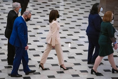 WASHINGTON, DC - APRIL 28:  U.S. Vice President Kamala Harris followed by Senate Majority Leader Chuck Schumer (D-NY) and Senate Minority Leader Mitch McConnell (R-KY) walk toward the House Chamber in Statuary Hall of the U.S. Capitol for a speech by U.S. President Joe Biden to a joint session of Congress in the House chamber of the U.S. Capitol April 28, 2021 in Washington, DC. On the eve of his 100th day in office, Biden spoke about his plan to revive America's economy and health as it continues to recover from a devastating pandemic. He delivered his speech before 200 invited lawmakers and other government officials instead of the normal 1600 guests because of the ongoing COVID-19 pandemic. (Photo by Sarah Silbiger-Pool/Getty Images)