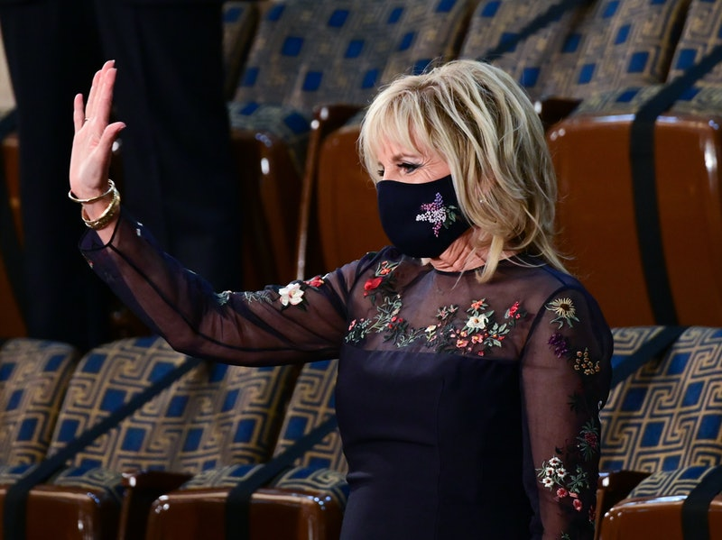WASHINGTON, DC - APRIL 28: U.S. first lady Dr. Jill Biden (R) arrives before a speech by President Joe Biden to a joint session of Congress in the House chamber of the U.S. Capitol April 28, 2021 in Washington, DC. On the eve of his 100th day in office, Biden is to speak about his plan to revive America's economy and health as it continues to recover from a devastating pandemic. He is scheduled to deliver his speech before 200 invited lawmakers and other government officials instead of the normal 1600 guests because of the ongoing COVID-19 pandemic. (Photo by Jim Watson - POOL/Getty Images)