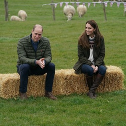 DARLINGTON, ENGLAND - APRIL 27:  Catherine, Duchess of Cambridge and Prince William, Duke of Cambridge sit on hay balls during a royal visit to Manor Farm in Little Stainton, Durham on April 27, 2021 in Darlington, England. (Photo by Owen Humphreys - WPA Pool/Getty Images)