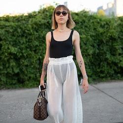 BERLIN, GERMANY - JULY 04:  Ema Etoile is seen attending Danny Reinke wearing black bodysuit with wh...