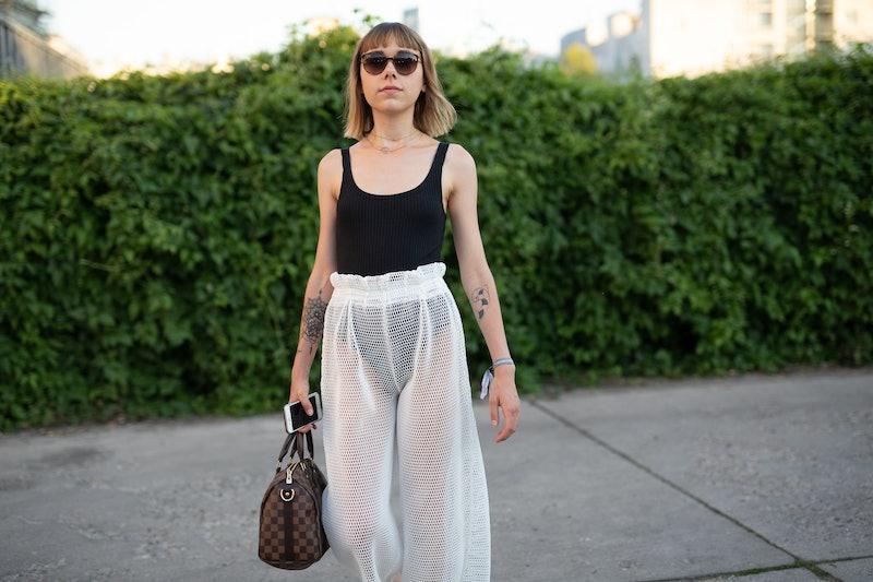 BERLIN, GERMANY - JULY 04:  Ema Etoile is seen attending Danny Reinke wearing black bodysuit with white scheer skirt during the Berlin Fashion Week July 2018 on July 4, 2018 in Berlin, Germany.  (Photo by Matthew Sperzel/Getty Images)