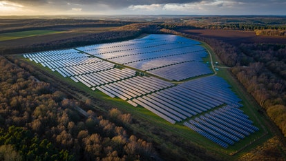 Aerial shot of large scale solar power generation. (Photo by: Mark Lees/Loop Images/Universal Images...