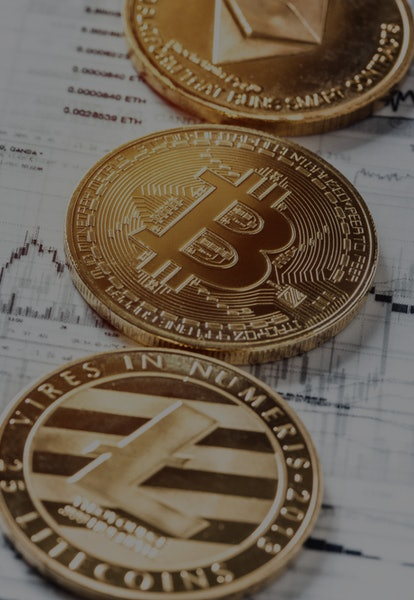 Crypto Currency Trading Techniques. Charts analytics printed on tracing paper. Studio shot of a Bitcoin virtual currency placed on printed trade charts with custom graphic design. Moscow, Russia - April 10, 2019