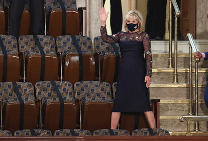 WASHINGTON, DC - APRIL 28:  First lady Jill Biden waves as she arrives for the speech by U.S. President Joe Biden to a joint session of Congress in the House chamber of the U.S. Capitol April 28, 2021 in Washington, DC. On the eve of his 100th day in office, Biden spoke about his plan to revive America's economy and health as it continues to recover from a devastating pandemic. He delivered his speech before 200 invited lawmakers and other government officials instead of the normal 1600 guests because of the ongoing COVID-19 pandemic.  (Photo by Jonathan Ernst-Pool/Getty Images)