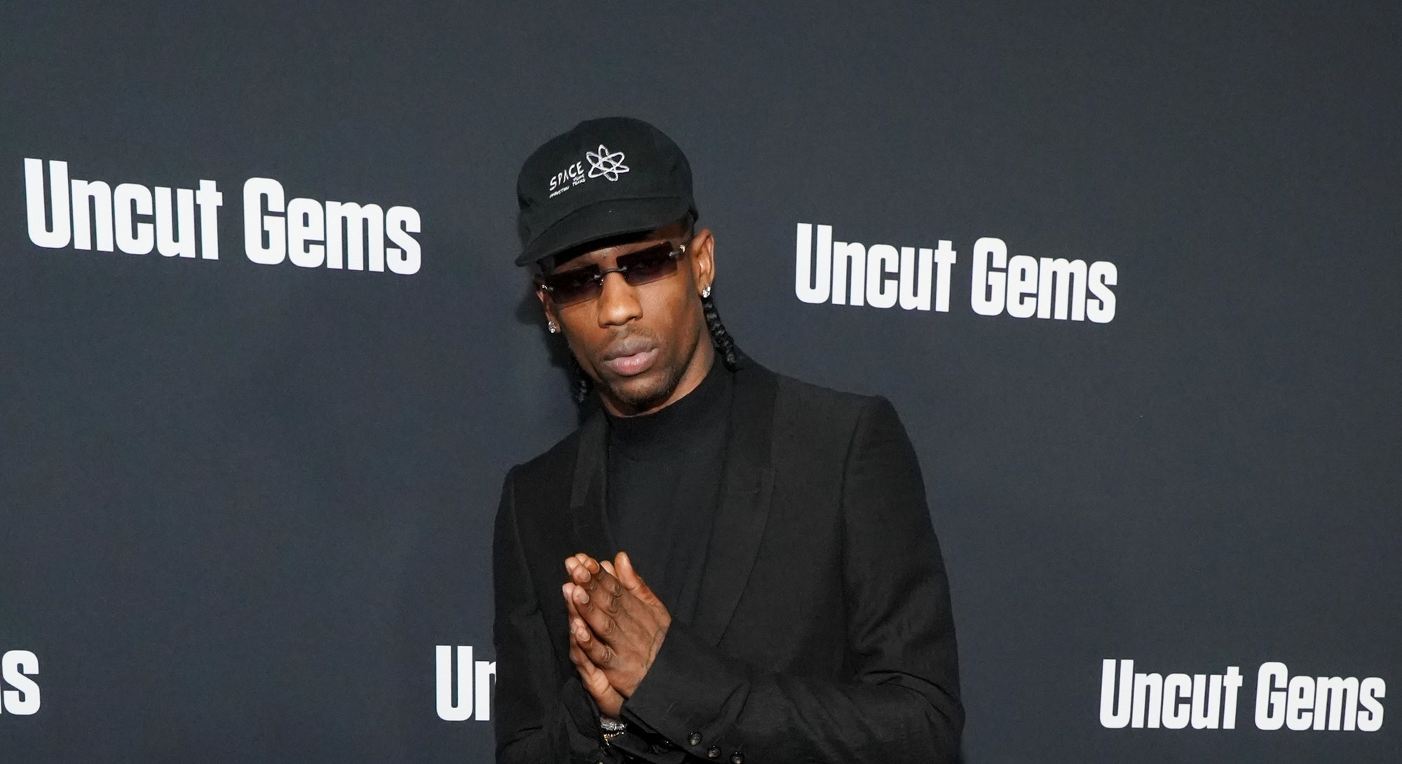 """HOLLYWOOD, CALIFORNIA - DECEMBER 11: Travis Scott attends the premiere of A24's """"Uncut Gems"""" at The ..."""