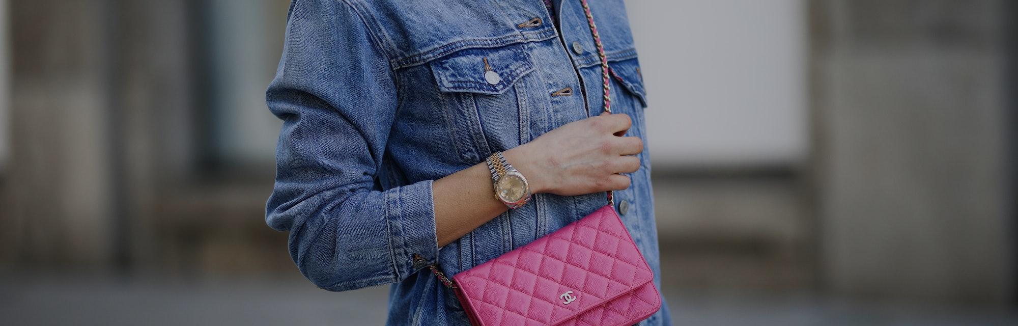 DUSSELDORF, GERMANY - MARCH 24: Scarlett Gartmann wearing Neo Noir flower mini dress, pink Chanel Wa...
