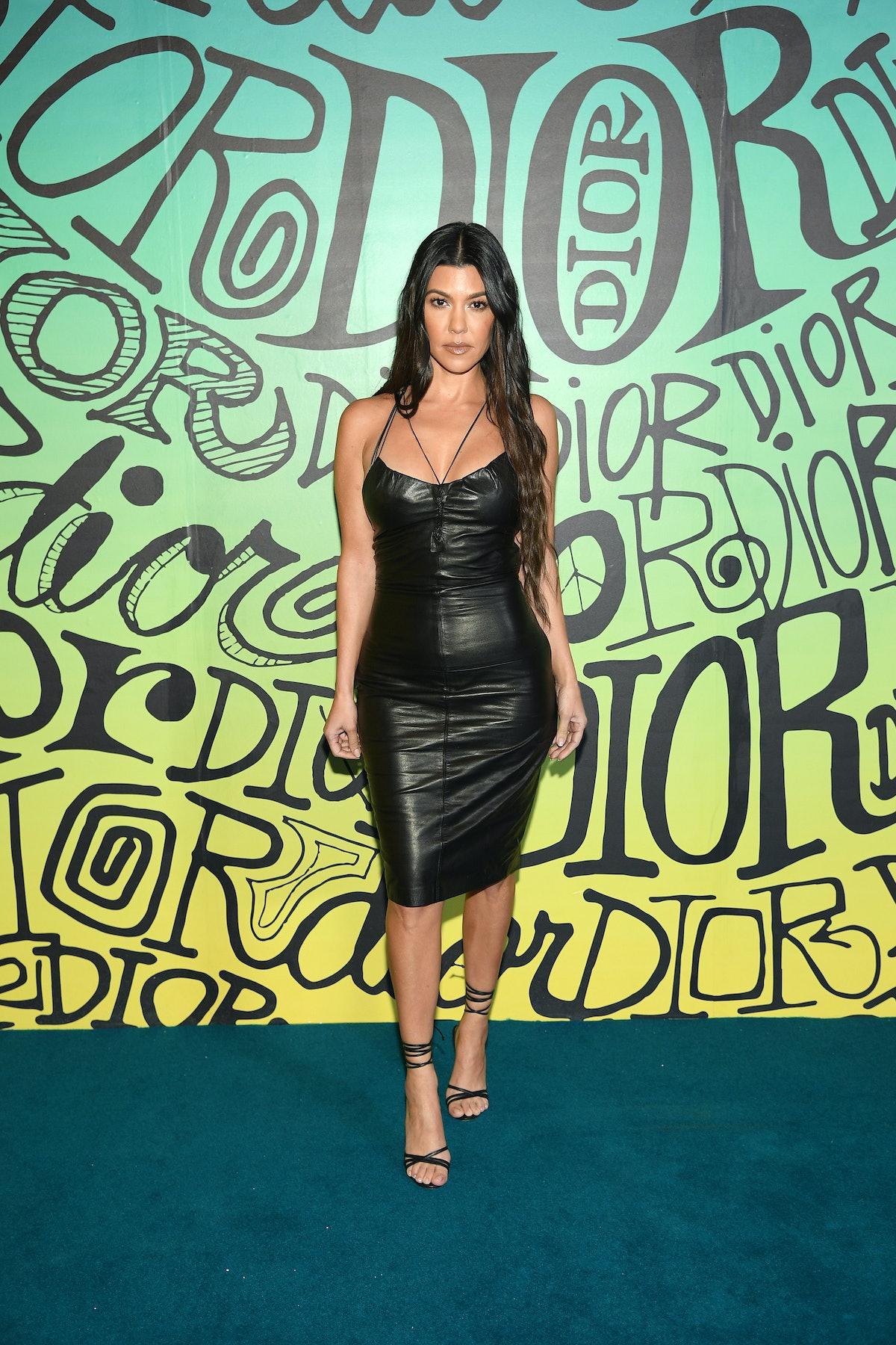 MIAMI, FLORIDA - DECEMBER 03: Kourtney Kardashian attends the Dior Men's Fall 2020 Runway Show on De...