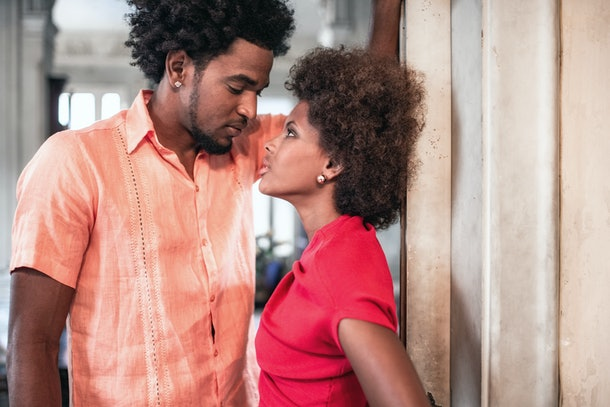 beautiful afro-caribbean woman and man in old house in Havana