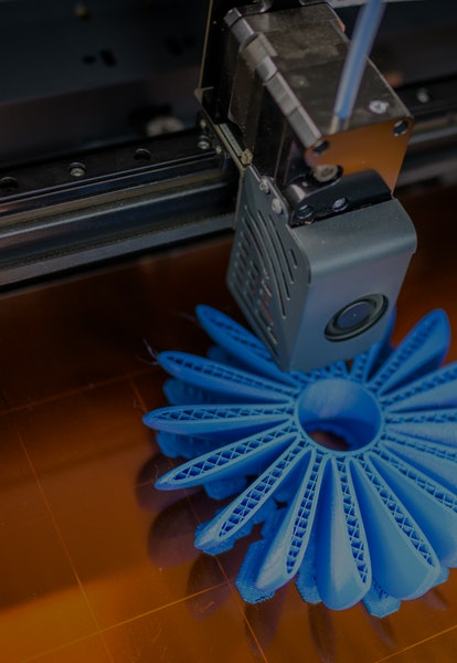 High angle view of plastic fan propeller 3D printing process.