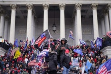 WASHINGTON, DC - JANUARY 06:  Protesters gather storm the Capitol and halt a joint session of the 11...