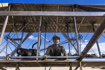 Sculpture of historic first flight at Wright Brothers National Memorial in Kill Devil Hills. (Photo by: John Greim/Loop Images/Universal Images Group via Getty Images)