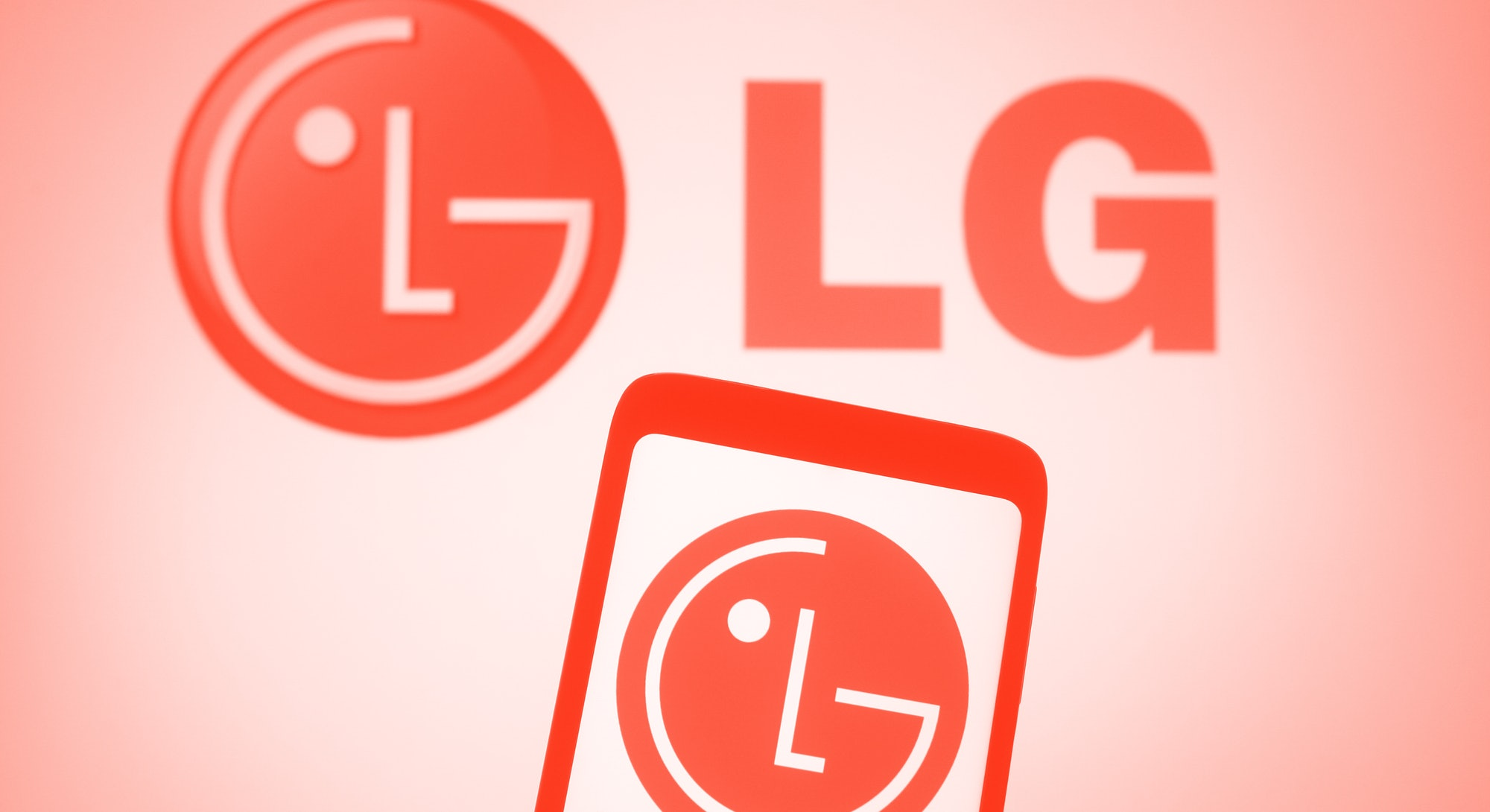 UKRAINE - 2021/03/15: In this photo illustration, LG logo seen displayed on a smartphone and a pc screen. (Photo Illustration by Pavlo Gonchar/SOPA Images/LightRocket via Getty Images)
