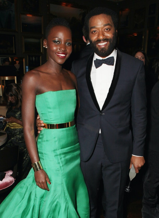 LONDON, ENGLAND - FEBRUARY 16:  Lupita Nyong'o and Chiwetel Ejiofor attend Entertainment One's BAFTA after party hosted by Grey Goose at The London Edition Hotel on February 16, 2014 in London, England.  (Photo by David M. Benett/Getty Images for Grey Goose)
