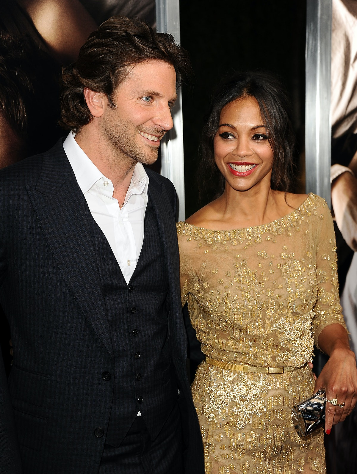 """HOLLYWOOD, CA - SEPTEMBER 04:  Actor Bradley Cooper and actress Zoe Saldana attend the premiere of """"..."""