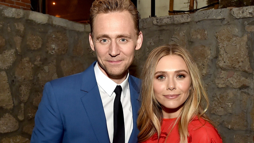"""LOS ANGELES, CA - MARCH 22:  Actors Tom Hiddleston (L) and Elizabeth Olsen pose at the after party for the premiere of Sony Pictures Classic's """"I Saw The Light"""" at Sadie's Kitchen on March 22, 2016 in Los Angeles, California.  (Photo by Kevin Winter/Getty Images)"""