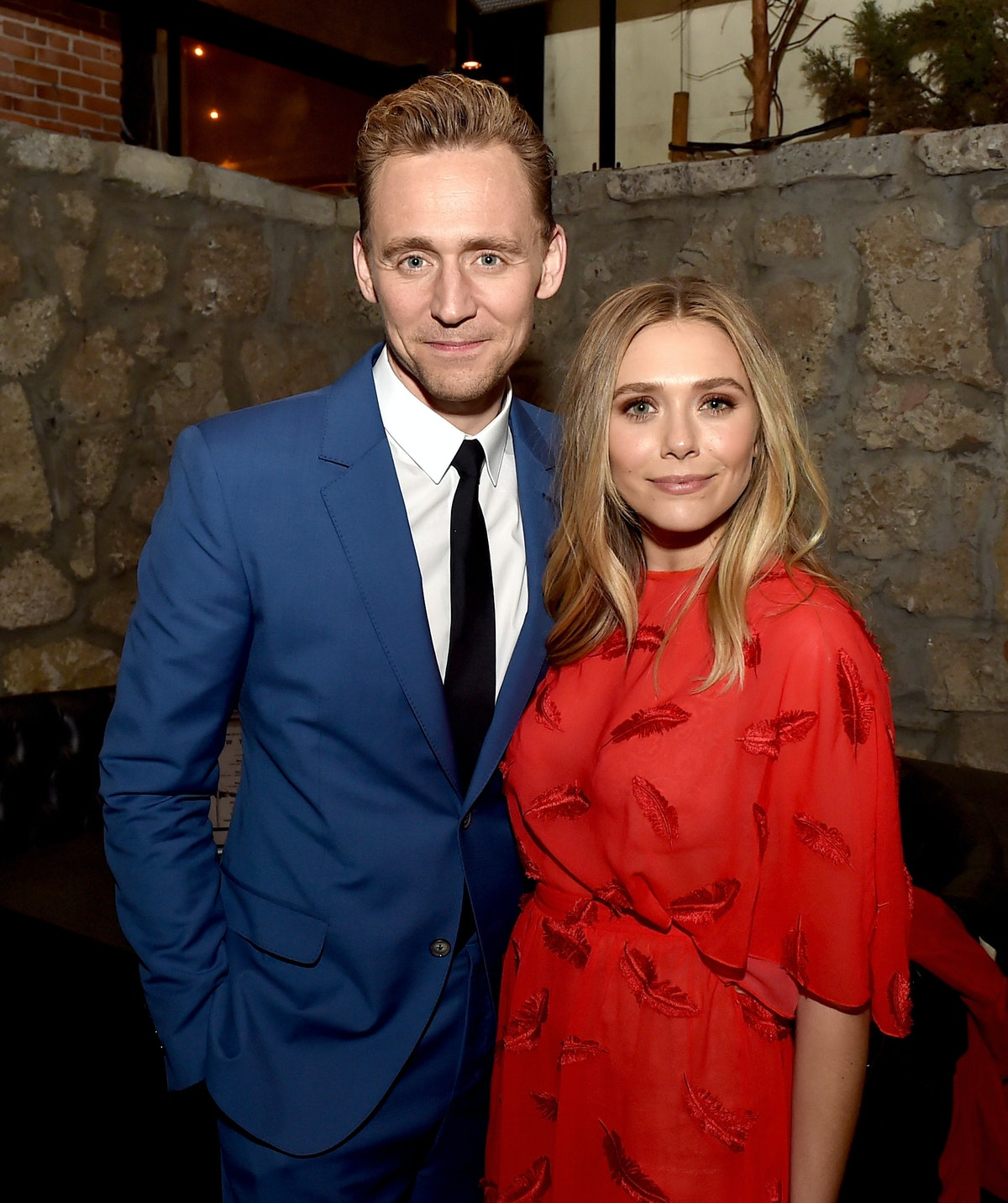 LOS ANGELES, CA - MARCH 22:  Actors Tom Hiddleston (L) and Elizabeth Olsen pose at the after party f...