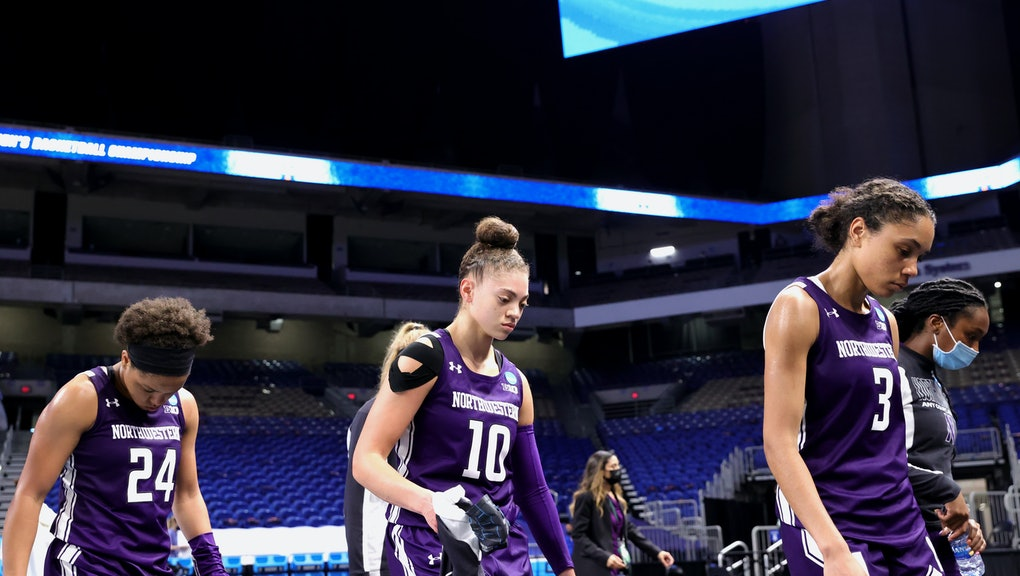 SAN ANTONIO, TEXAS - MARCH 24: Lindsey Pulliam #10, Jordan Hamilton #24, and Lauryn Satterwhite #2 of the Northwestern Wildcats leave the court after losing to the Louisville Cardinals in the second round game of the 2021 NCAA Women's Basketball Tournament at the Alamodome on March 24, 2021 in San Antonio, Texas. (Photo by Carmen Mandato/Getty Images)