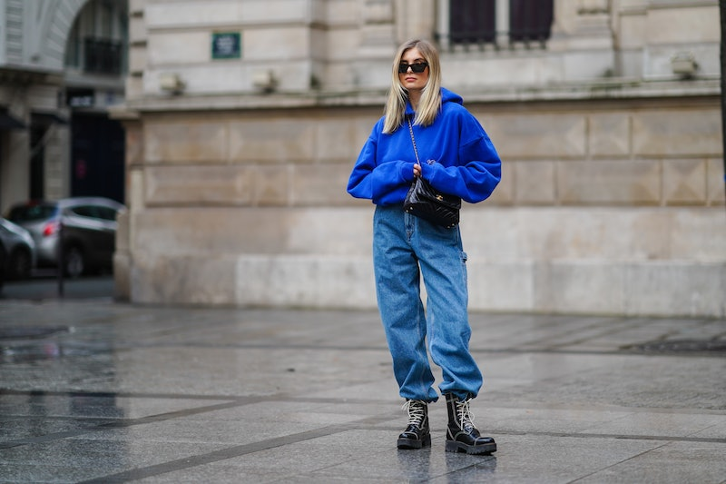 PARIS, FRANCE - MARCH 11: Xenia Adonts wears sunglasses from Linda Farrow, a bold blue hoodie sweate...