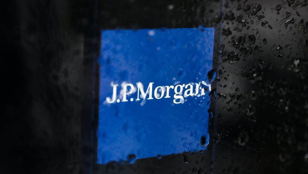 JP Morgan logo displayed on a phone screen is seen through raindrops on the window in this illustration photo taken in Poland on November 30, 2020. (Photo by Jakub Porzycki/NurPhoto via Getty Images)