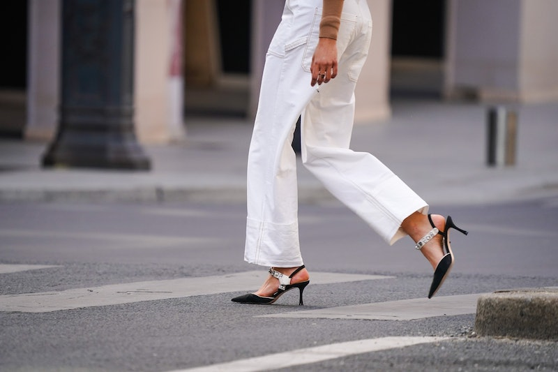 PARIS, FRANCE - MAY 14: A passerby wears white jeans, bejeweled pointy shoes, in the streets of Pari...