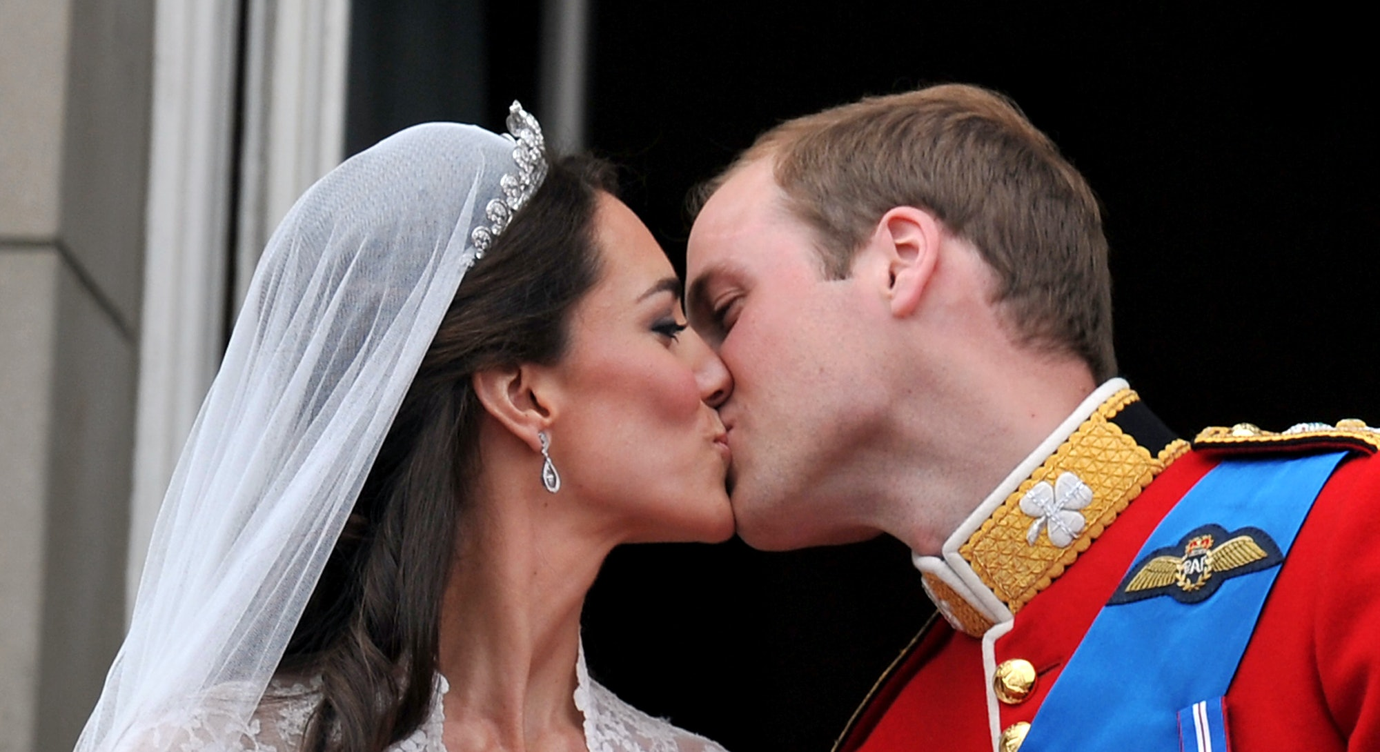 Prince William and his wife Kate Middleton, who has been given the title of The Duchess of Cambridge, kiss on the balcony of Buckingham Palace, London, following their wedding at Westminster Abbey.   (Photo by John Stillwell/PA Images via Getty Images)