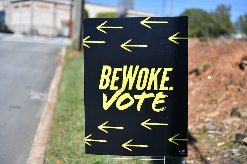 "ATLANTA, GEORGIA - OCTOBER 17:  A sign reads ""Be Woke. Vote."" The meaning of woke slang term has evolved over the years."