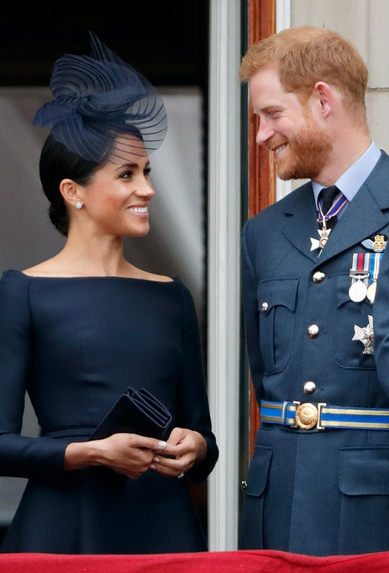 LONDON, UNITED KINGDOM - JULY 10: (EMBARGOED FOR PUBLICATION IN UK NEWSPAPERS UNTIL 24 HOURS AFTER CREATE DATE AND TIME) Meghan, Duchess of Sussex and Prince Harry, Duke of Sussex watch a flypast to mark the centenary of the Royal Air Force from the balcony of Buckingham Palace on July 10, 2018 in London, England. The 100th birthday of the RAF, which was founded on on 1 April 1918, was marked with a centenary parade with the presentation of a new Queen's Colour and flypast of 100 aircraft over Buckingham Palace. (Photo by Max Mumby/Indigo/Getty Images)