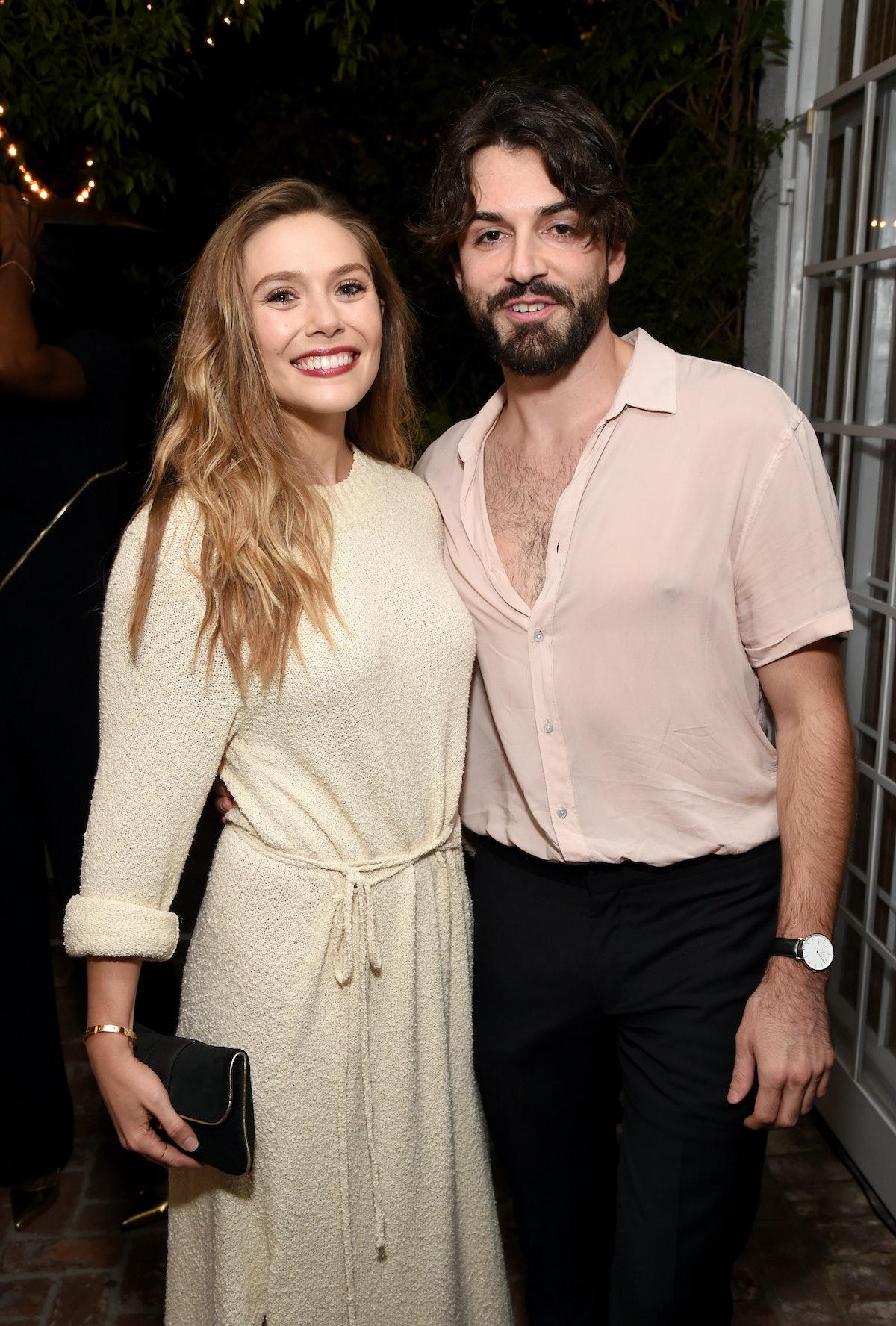 LOS ANGELES, CA - SEPTEMBER 15:  Elizabeth Olsen (L) and Robbie Arnett attend the 2017 Gersh Emmy Pa...