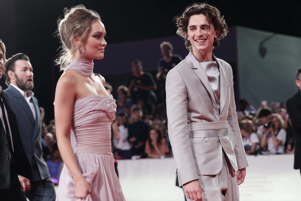 """VENICE, ITALY - SEPTEMBER 02:  Lily-Rose Depp and Timothee Chalamet attend """"The King"""" red carpet dur..."""