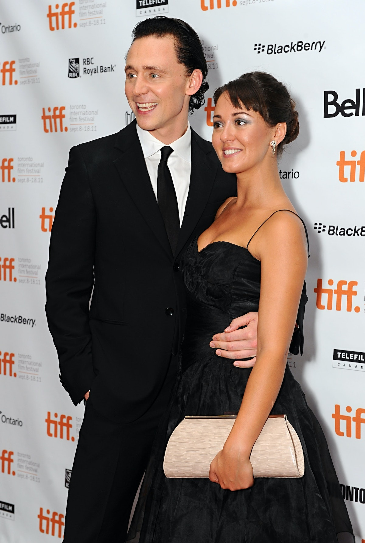 """TORONTO, ON - SEPTEMBER 11:  Actors Tom Hiddleston and Susannah Fielding attend the premiere of """"The..."""