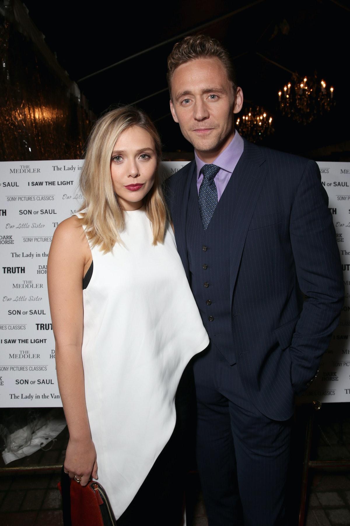 TORONTO, ON - SEPTEMBER 12: Actors Tom Hiddleston (L) and Elizabeth Olsen attend the SPC Toronto Par...