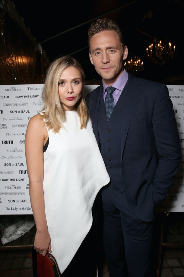TORONTO, ON - SEPTEMBER 12: Actors Tom Hiddleston (L) and Elizabeth Olsen attend the SPC Toronto Party during the 2015 Toronto International Film Festival at Creme Brasserie on September 12, 2015 in Toronto, Canada.  (Photo by Todd Williamson/Getty Images for SPC)