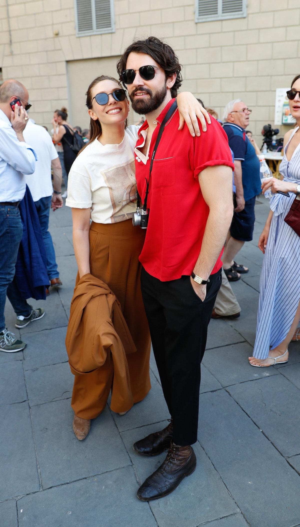 VILLA CETINALE, ITALY - JULY 02: Elizabeth Olsen and Robbie Arnett attend Rosetta Getty's  third ann...