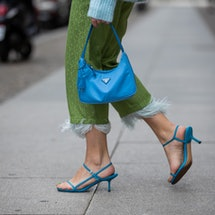 BERLIN, GERMANY - MAY 19: Sonia Lyson is seen wearing blue sandels Ducie, green cropped pants Milk White, blue Prada bag, turquoise knit Zara on May 19, 2020 in Berlin, Germany. (Photo by Christian Vierig/Getty Images)