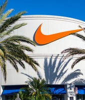 Orlando, USA - February 15, 2014: Photo of facade of Nike Store  at Orlando Premium Outlets, located at 8200 Vineland Avenue, Orlando. It was a sunny and clear day. Palm trees in front the store.