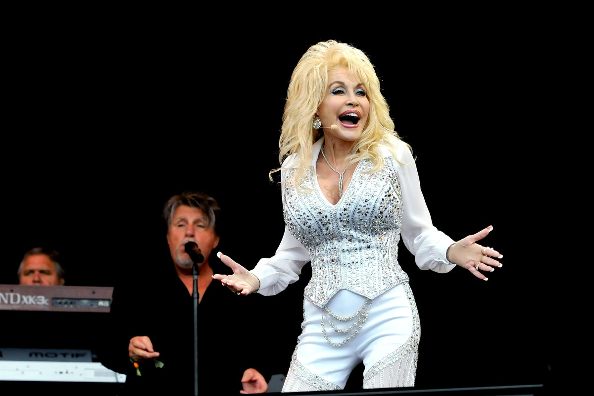 GLASTONBURY, ENGLAND - JUNE 29:  Dolly Parton performs on the Pyramid stage during day three of the Glastonbury Festival at Worthy Farm in Pilton on June 29, 2014 in Glastonbury, England. Tickets to the event, which is now in its 44th year, sold out in minutes even before any of the headline acts had been confirmed. The festival, which started in 1970 when several hundred hippies paid £1, now attracts more than 175,000 people.  (Photo by Jim Dyson/Getty Images)