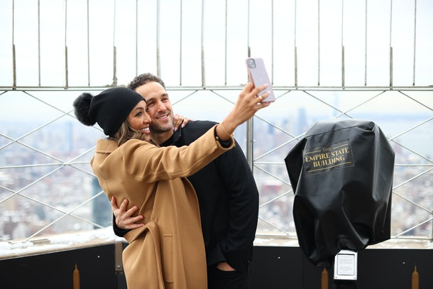 NEW YORK, NEW YORK - FEBRUARY 12: Tayshia Adams and Zac Clark celebrate their love at The Empire State Building on February 12, 2021 in New York City. (Photo by Dimitrios Kambouris/Getty Images for Empire State Realty Trust)